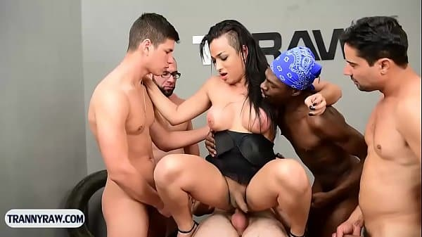 Brazilian tranny gangbang fucked by a group of horny guys